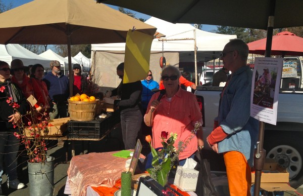 Clark Wolf in his orange pants, Gaye LeBaron in an orange shirt and Middleton Farm Gardens final market stall on Sunday, February 1.