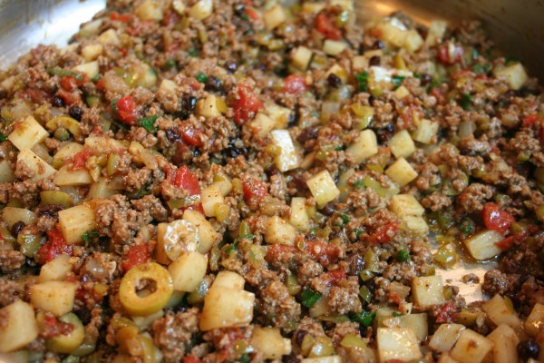 Picadillo often includes olives and potatoes in addition to ground meat and spices